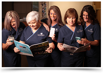 dental office staff reading news in magazines and on their mobile devices
